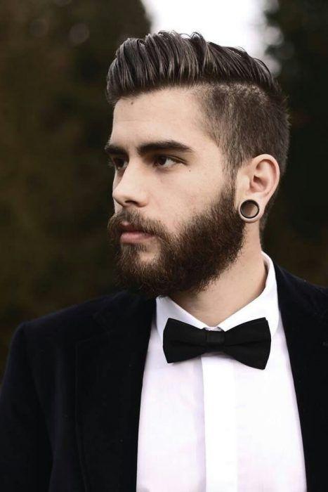 Hombre con traje, barba, expansiones y corte de cabello dapper