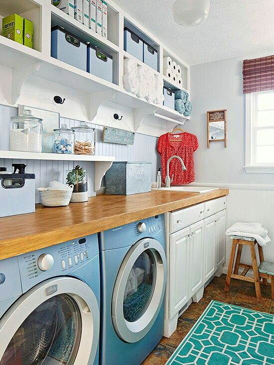 The design for this laundry room needed to maximize long-term storage but maintain counter space for workaday tasks. To do that, the homeowners installed a narrow shelf a few inches above the countertop, using turned shelf supports to add classic details to the space. Hooks add even more quick-use storage.