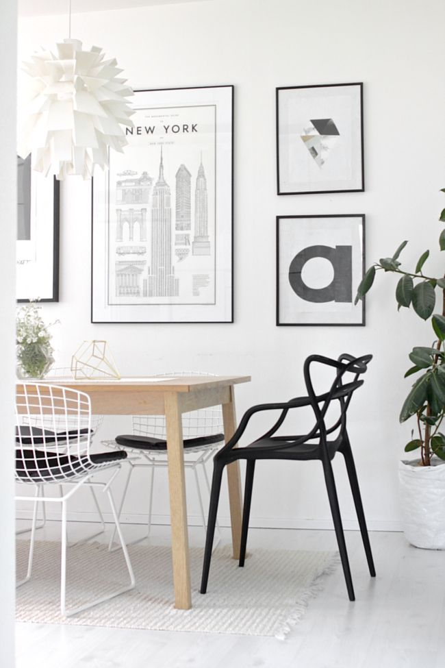Monochrome art prints, Normann Copenhagen 69 pendant, vintage refurbished white Bertoia Wire side chairs mixed with black Kartell Master's chairs.