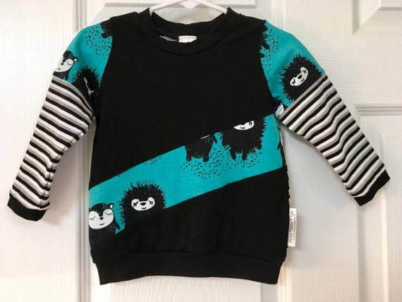 This cute and comfy Hedgehogs shirt (Size 9-12 Months) is color blocked to make it very stylish. Match it with the fake faux pocket jogging pants for a very trendy outfit.