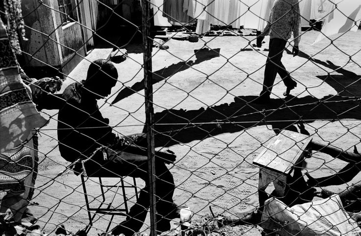 Paolo Pellegrin. ZIMBABWE, Harare 2001. In a slum on the outskirts of town, a young man is dieing of AIDS. The average life expectancy has dropped from 56 in 1999 to less than 30 in 2003.Each week, in Zimbabwe, 2 000 people die of AIDS or from a related illness