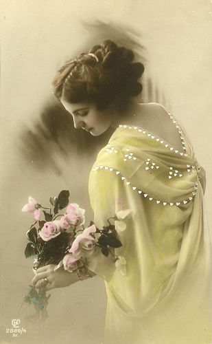 Woman in yellow dress, holding pink tinted roses
