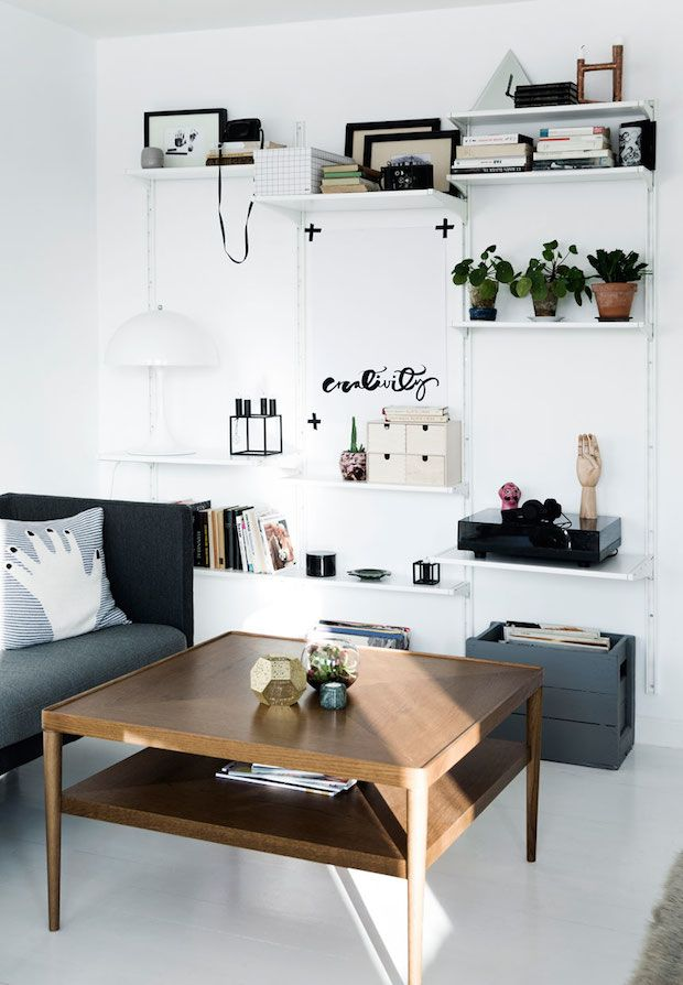 floor to ceiling shelving and mid-century in the sitting room. A Danish home is given a fresh, monochrome make-over. Tia Borgsmidt.