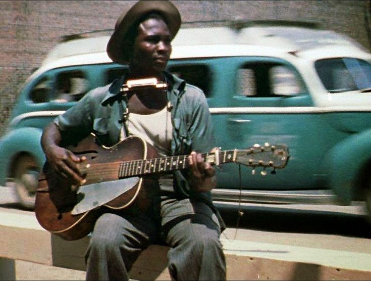 """Portrait of blues guitarist and singer David """"Honeyboy"""" Edwards, Clarksdale, Mississippi, United States, 1942, photograph by Alan Lomax."""