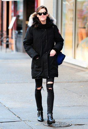 When a big black parka's obscuring most of an outfit, waist-down details become more important. On off-duty days, try for denim distressing and boot buckles. Lucky, 31 Perfect December Outfits