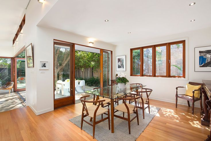 Beautiful family home, big dining zone opening to north-west facing garden, dining setting, sitting chair, Pilcher Residential