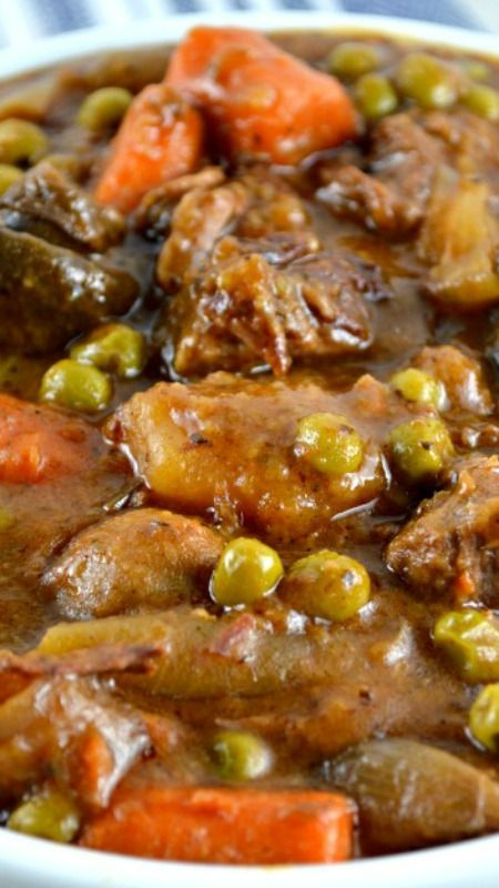 Easy Crockpot Beef Stew ~The gravy is thick and rich and deliciously beefy. It's loaded with lots of mushrooms, potatoes, carrots, peas and great herbs!