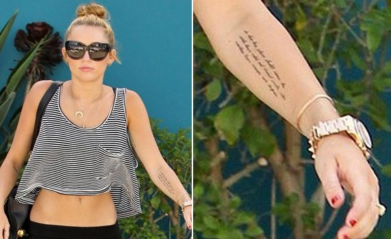 """Miley Cyrus got some more ink. This time she went for a very large, visible, and yet thoughtful tattoo on her forarm. It is a quote from a speech given by President Theodore Roosevelt in 1910. Miley must be well versed in her social/political history. The quote reads """"So that his place shall never be with those cold and timid souls who knew neither victory nor defeat."""""""