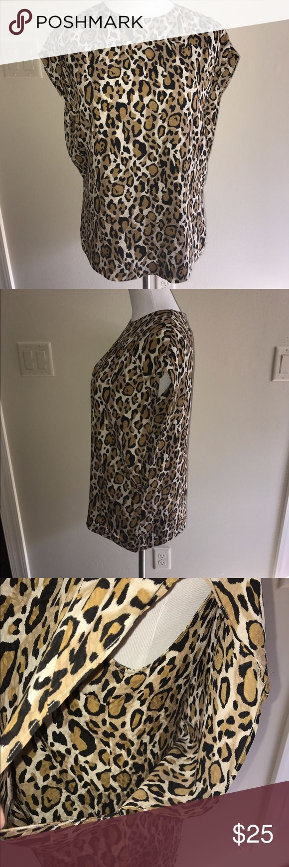 Tory Burch Silk leopard pullover size 6 Tory Burch 100% silk Leopard pullover size 6. Perfect condition, Tory Burch Tops Blouses