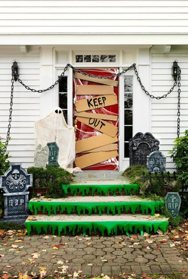 Make a ghostly graveyard scene with this DIY Halloween door decor project.