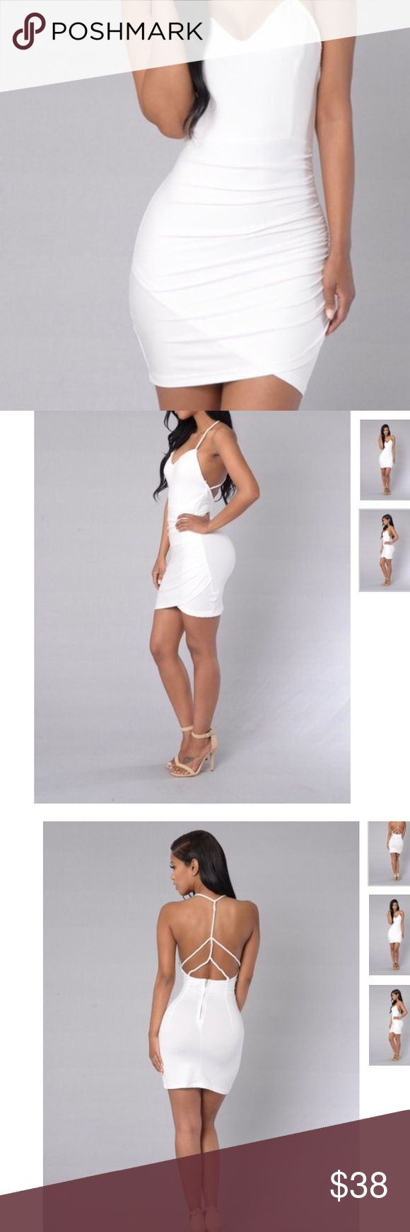 White club dress new. Summer strappy and sexy Cute stretchy summer white dress form fit and comfy sexy rope back. Tagging nasty gal for exposure Nasty Gal Dresses Mini