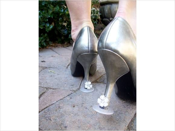High heel stoppers for grass... great for an outdoor wedding. hand them out to guest at the reception.