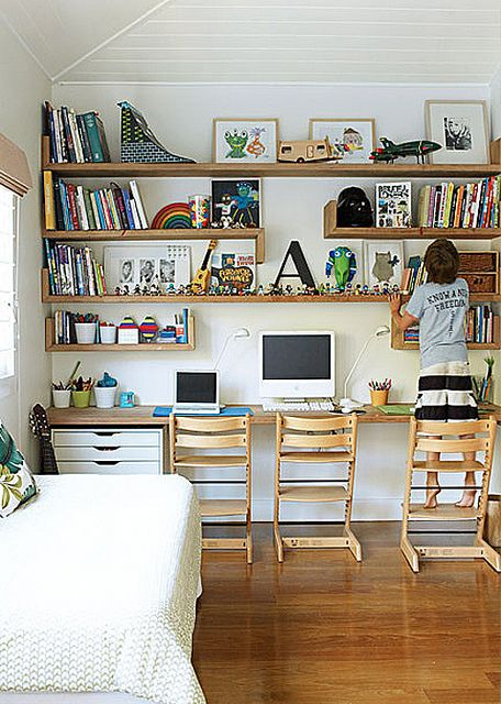 Children's study area with shelving floor to ceiling. So practical.