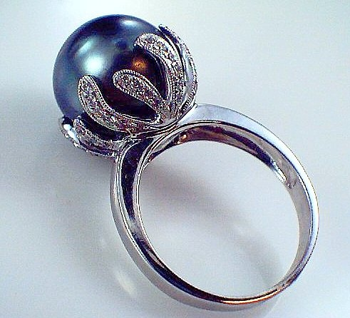 Black #Tahitian #pearl #ring set in coral style setting