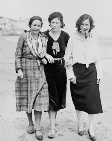 Rosa Luxemburg, Simone de Beauvoir, and Emma Goldman on the beach, smoking pipes (1930s)