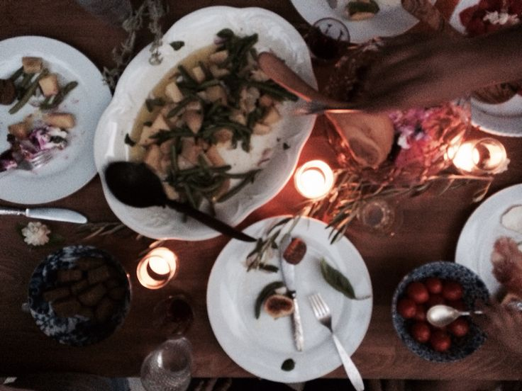 small gathering, friends and family enjoying local food and wine, in Ikaria island, Greece.