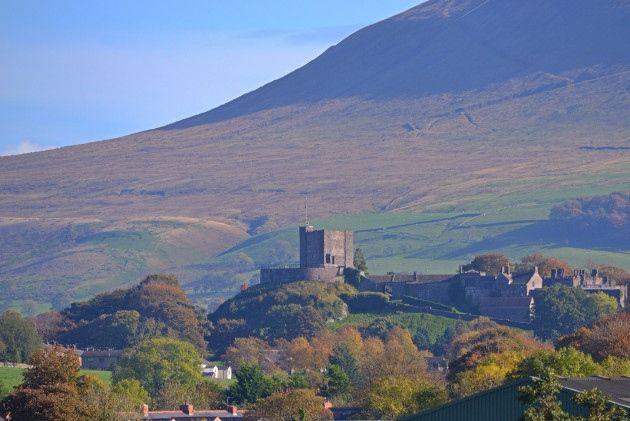 Clitheroe Castle against backdrop of Pendle Hill - Photos - Lancashire Life