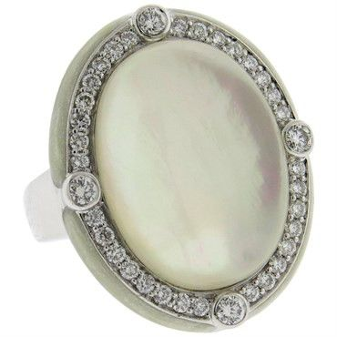 Large cocktail 18k white gold ring, crafted by Ivanka Trump, featuring crystal top, backed with mother of pearl, surrounded with approximately 0.76ctw in diamonds and enamel rim. DESIGNER: Ivanka Trum