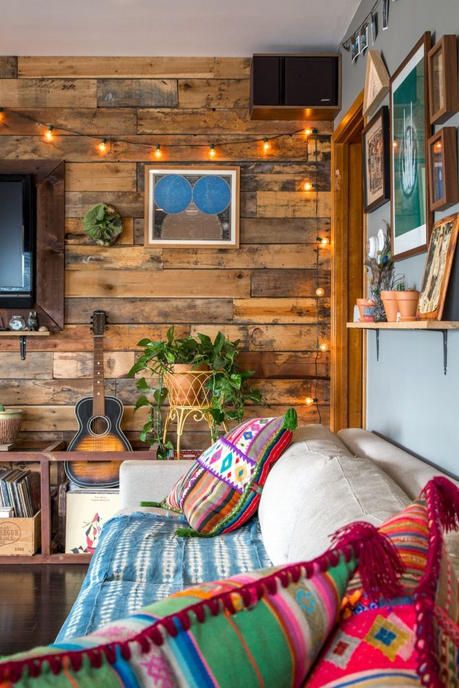 Peruvian pillows in a rustic wood paneled living room