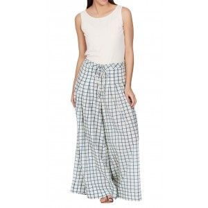 An ivory printed palazzo pants in cotton. These designer palazzos are adorned with an all over geometric checkered print. Style these Indian palazzo pants with a matching top and a classic Ritu Kumar bag.