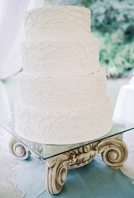 Brides: Textured Four-Tier Wedding Cake. A four-tiered white wedding cake with modern piping created by Publix.