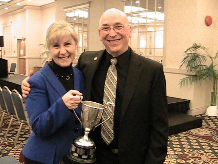 Carol and Gene with District 21 International Speaking Championship Trophy