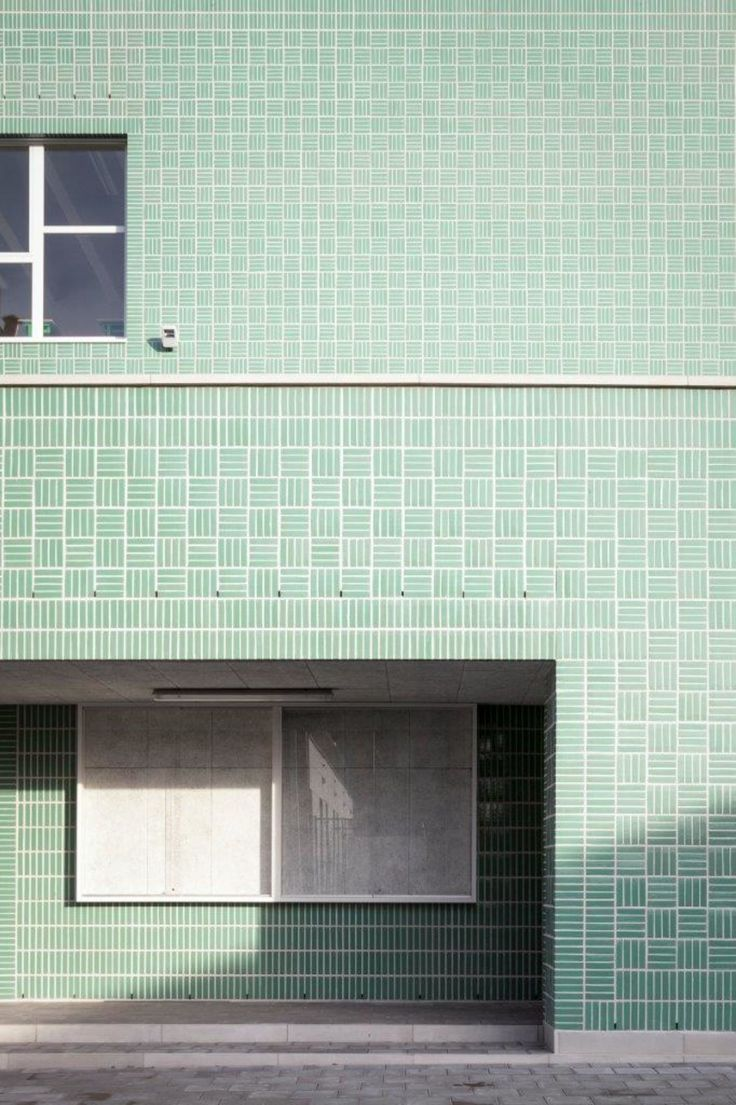 Glazed mintgreen brickwork is cladding this stacked open school project.  A polyvalent playground sits on top of the elementary school and opens up to the neigbourhood to create a school project in dialogue with the surroundings.  Outside staircases ac...