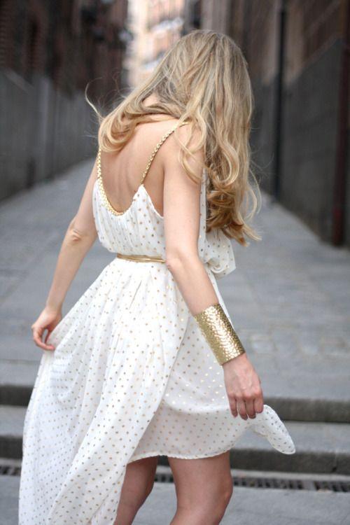 Golden poke a dots on a white dress <3