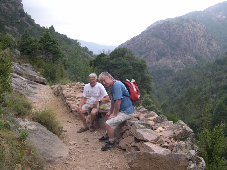 Gerard and I pause on a 1500 meter climb up the hills of Corsica above the cute coastal town of Calvi.