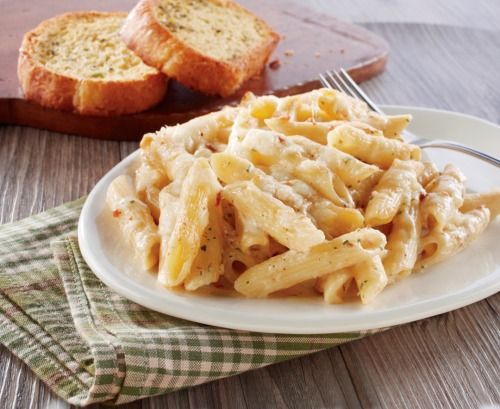 Ranch with Bacon Mac and Cheese   • ½ of a 1lb. package penne pasta,   cooked and drained   • 1 jar (14.5 oz.) Prego® Alfredo Sauce   Flavored with Bacon   • ½ of a 1 oz. envelope ranch salad   dressing mix   • ½ cup shredded Monterey Jack Cheese   Heat the oven to 350ºF. Stir the penne, sauce, dressing mix, and half the   cheese in a large bowl. Spoon the penne mixture into an 8x8x2-inch   baking dish. Sprinkle with the remaining cheese. Bake for 30 minutes or   until the penne mixture is…