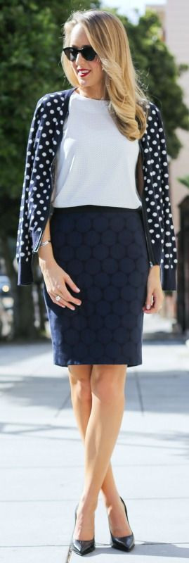 black and navy graphic polka dot pencil skirt, navy and white polka dot cardigan sweater with black leather trim, mixed prints at work