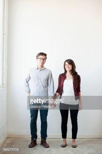 Stock Photo : Portrait of couple holding hands indoors