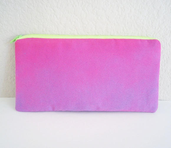 This bag is soft and light and made with a purple faux suede fabric that has been painted in a hot pink neon blend. Both sides are different- front has a stronger blend at the top, back is more subtle with a slight pink blend at the bottom.
