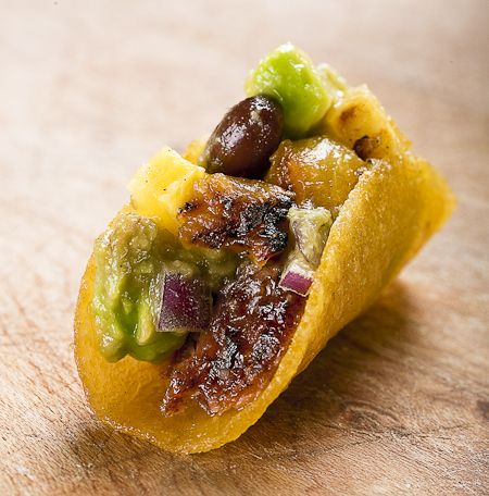 Pulled pork taco with black bean salsa and grilled pineapple yumm definitely making this tonight!