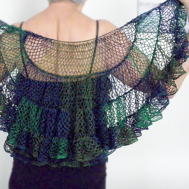 Ravelry: Sophias Shawl pattern by Margaret Zellner: This shawl is similar to the Kelp Forest Shawlette but it is a half-circle, not a circle. Starting from the neck, the rows are made by crocheting the thin edge into the wide edge. The tricky part is turning at the end of each row. To do this, fold the yarn under at 45° and slip stitch across to the wide edge. The pattern includes detailed photos.