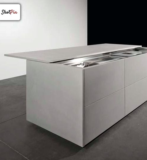 MK Cucine. Minimal kitchen island with sliding counter top.