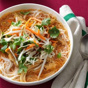 Coconut Curry Chicken Soup Recipe -Similar to a Vietnamese pho rice noodle soup, this red curry soup packs big flavor and a bit of heat. The crisp raw vegetables help cool things down. —Monnie Norasing, Mansfield, Texas