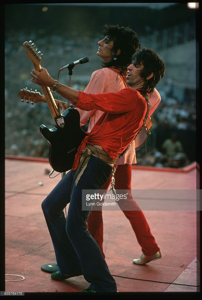 Guitarist Keith Richards (front) and bassist Ron Wood (back) perform during a Rolling Stones concert.