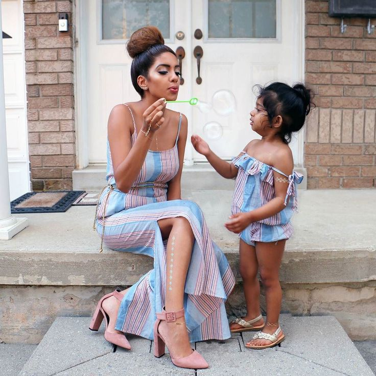 How adorbs are these Mommy and Me rompers from @plumprettysugar  We're going to rock these all summer! . Hand piece- @Haatichai Shoes- @fashionnova Temp metallic tattoos are from Amazon