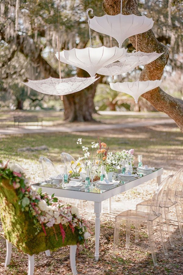 This outdoor vintage bridal shower has a dash of playfulness and dollop of absolute pretty with a floral throne and hanging parasols for us to daydream.