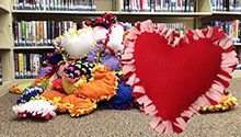 If you're looking for a program that makes everyone feel good, this is it. The Bedford (Ind.) Public Library presented two workshops where attendees cut, tied and stuffed 137 no-sew pillows for donation to the special needs wing of a local nursing home. The library made it possible for even young children to participate.