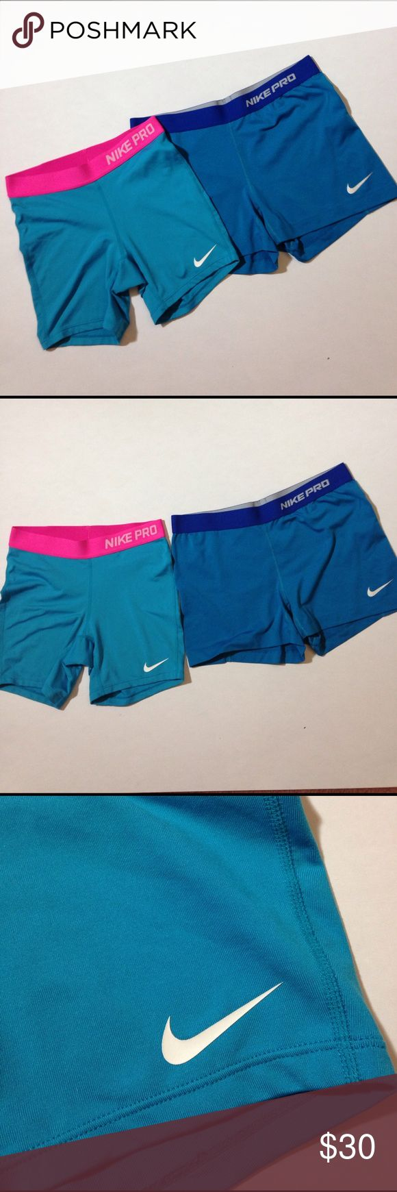 "1 HR⚡Bundle 2 Nike Pro shorts Bundle of 2 Nike compression shorts, the pink band is size XL but run smaller and is a longer style. The band measures 12.25"" across and from top of band down measures approximately 12.5"" long. The blue band ones are size XL and are shorter and the waist from side to side measures approximately 14.5"" across and from band down measures approximately 12"" long. Nike swoosh has some cracking on blue band pair. Nike Shorts"