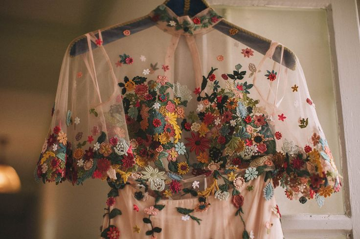 The bride designs bespoke wedding dresses for a living so this designer crafted a one-of-a-kind blush pink wedding gown that had so many tiny flowers sewn onto it!