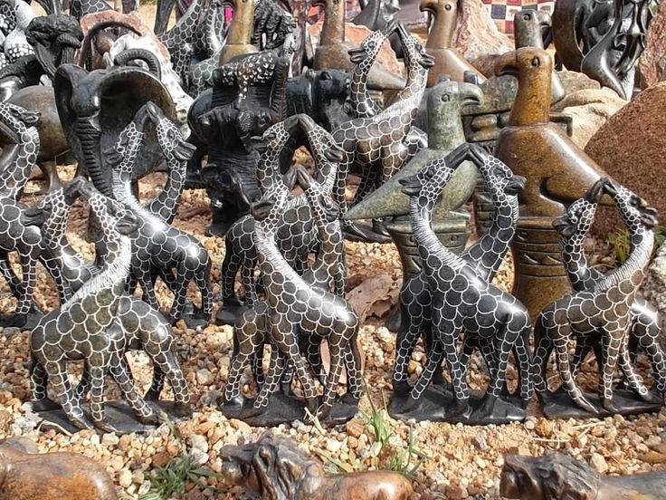 Giraffe Pairs 40cm height sculptured from the mashona stones by Zimbabwean sculpturos