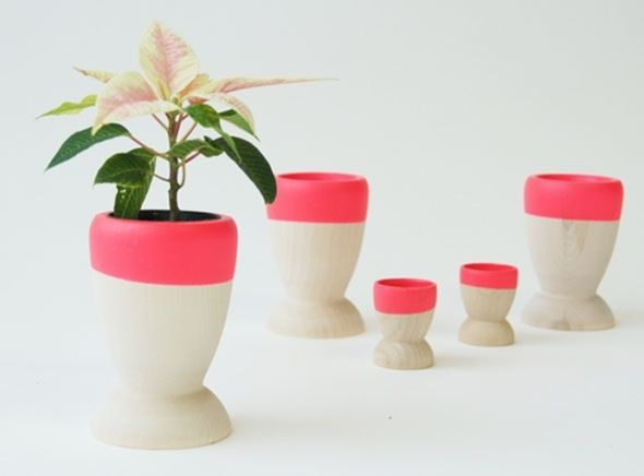 Beautiful small wooden planter is bigger than the mini but small enough to add a splash of colour to any roomThese planters look great with small cactus, succulents or herbsPlanters are made from solid birch and are hand dipped in synthetic rubberSize is approx 11.4cm high x 8.25cm wide at the top x 7.5cm at the baseDesigned and created by Wind