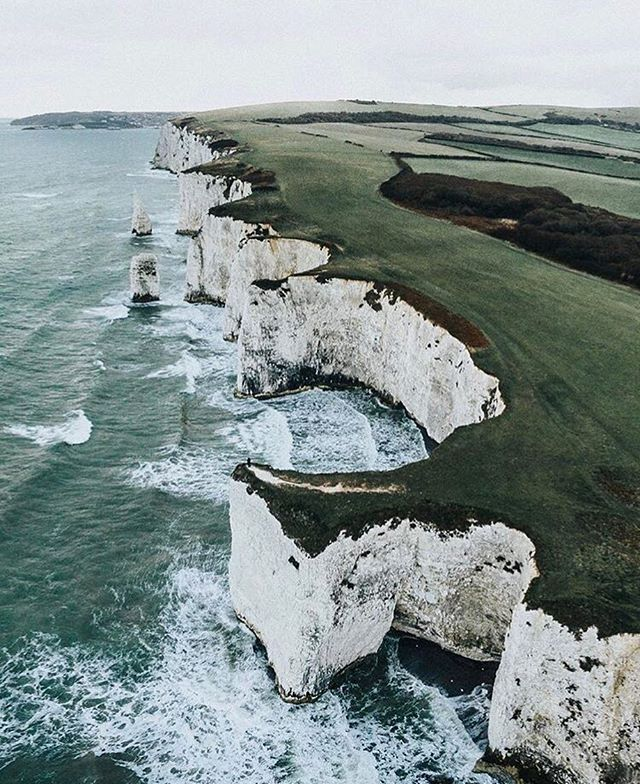 Old Harry Rocks are three chalk formations, including a stack and a stump, located at Handfast Point, on the Isle of Purbeck in Dorset, southern England. They mark the most easterly point of the Jurassic Coast, a UNESCO World Heritage Site * Photo by @ryansheppeck * Tag us to be featured
