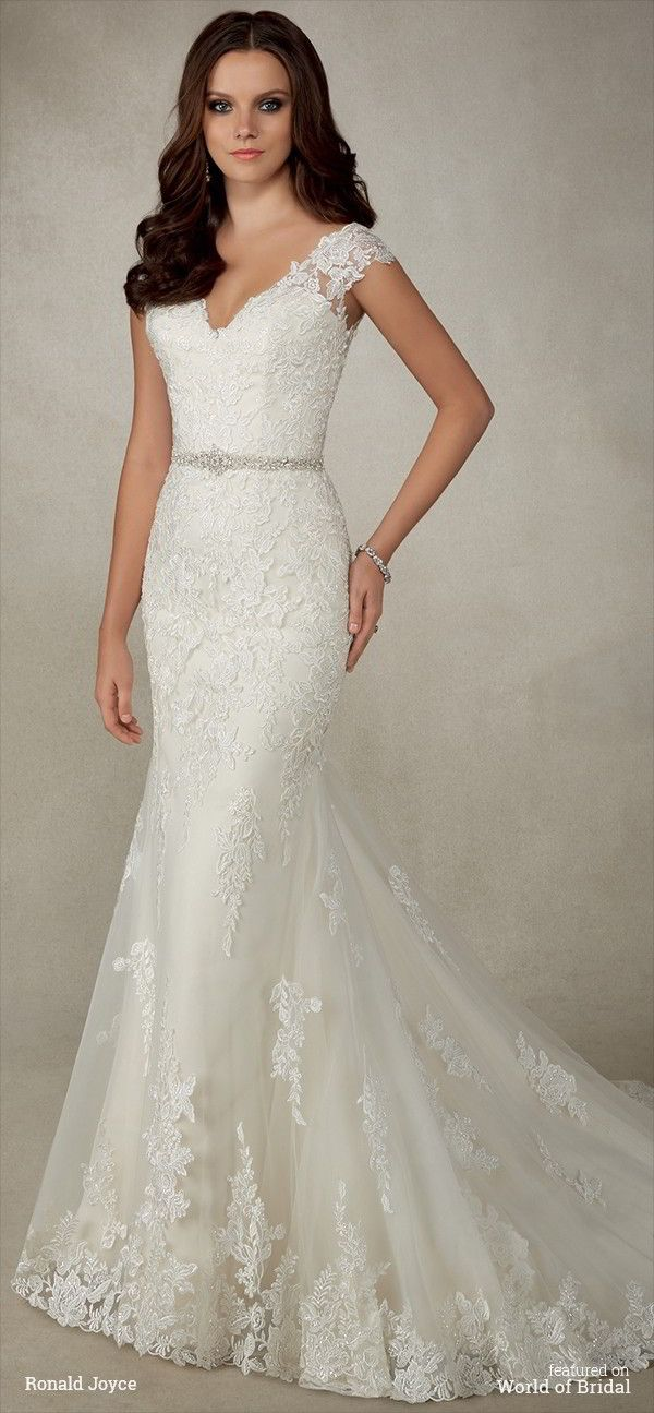 A slim fitting dress with lace cap sleeves and stunning plunge back with a beaded waistband