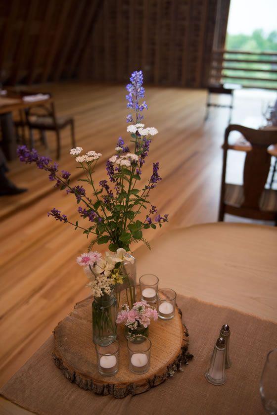 A Catskills Farmhouse Wedding: Freshly picked wildflowers, vintage bottles, votives, tree slice. // The Inn at West Settlement | Amber J Photography