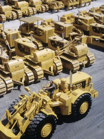 Rows of Brightly Colored Caterpillar Bulldozers Lined up at an Unidentified Factory Photographic Print by John Zimmerman at AllPosters.com