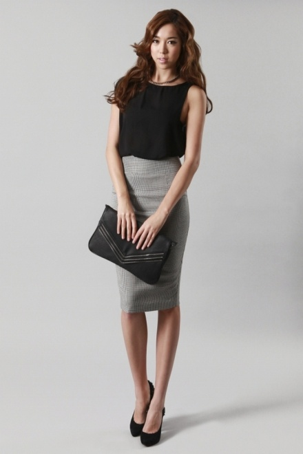 Chic work to going out look.  Sleeveless black top, gray pencil skirt, and black heels accessorized with large black clutch.